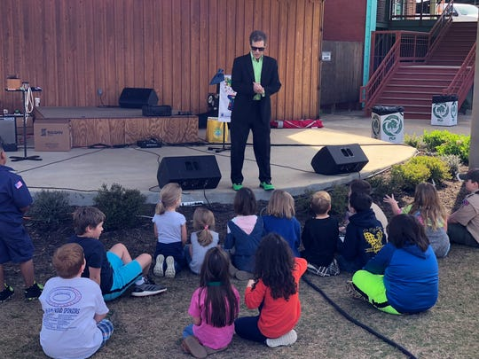 "Magician Jerry White performs his ""Make Litter Disappear"""