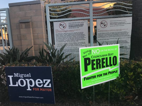 Political signs for the Oxnard special election are seen outside Pacifica High School. The campus  was the site of a candidates debate in March hosted by the League of Women Voters.