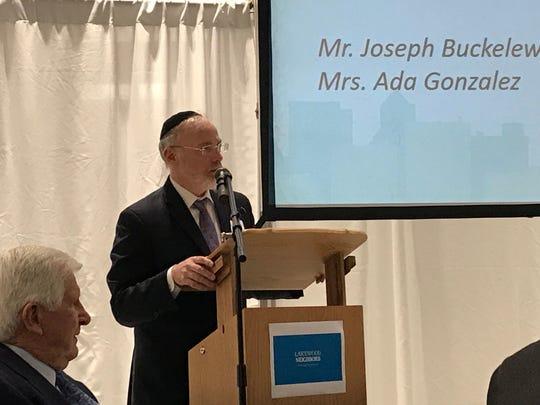 Beth Medrash Govoha yeshiva President Rabbi Aaron Kotler emcees the launch of the Lakewood Neighbors coalition last year at Pine Belt Chevrolet in Lakewood.