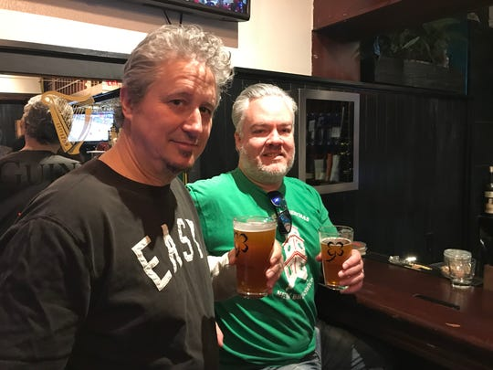 New Brunswick residents Michael Tublin and Scott Fenton enjoy craft beers at the new Blackthorn Restaurant & Irish Pub on Church Street.