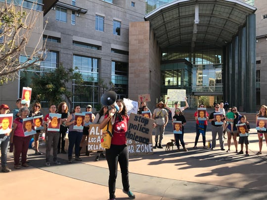 """Dozens of protesters gathered outside Tucson's federal courthouse Monday to protest a """"not guilty"""" verdict in the case of a Border Patrol agent that shot and killed an unarmed Mexican teenager through the border fence in Nogales."""