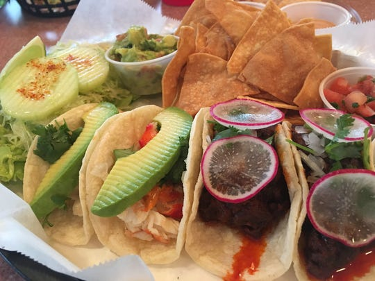 King crab tacos and steak tacos cooked in red chiles at Las Tortugas.