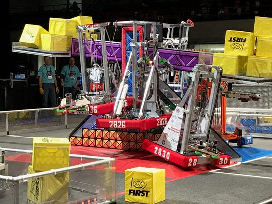 Wave's robot pulls itself up for bonus points in the regional finals.