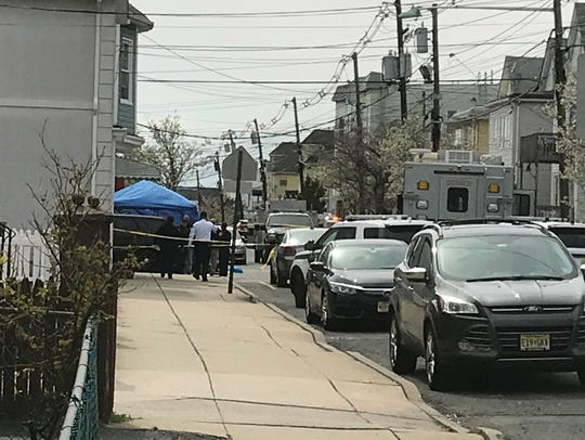 Police at the scene in Garfield, where a juvenile was