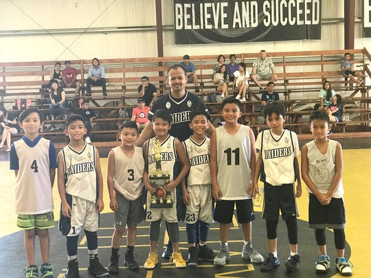 The under-10 Raiders, who won the Under-10 Elite Basketball Spring Tournament April 22 at the Guam Elite Gym in Tiyan, beating the Island Wolves 28-24. From left: Tristan Hahn, Josiah Madrazo, Addison De Los Santos, Jarret  Ko, Collin Baker, Jordan  Madrazo, Cameron Arriola and Gavin Boyd. Standing is Coach Aguon.