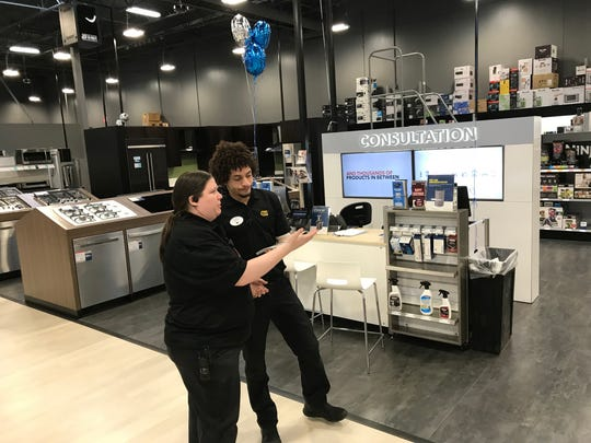 Kelly Benenati, left, appliance manager at the new Best Buy, talks with an associate next the consultation desk.