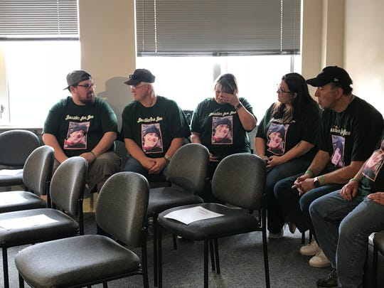 "Family members of road-rage victim Joseph Pirri of Blackwood wear ""Justice for Joe"" shirts as they await a press conference to announce an arrest in the case."