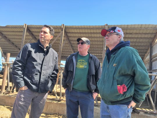 Gov. Scott Walker meets with Leon and Dennis Gohr inside