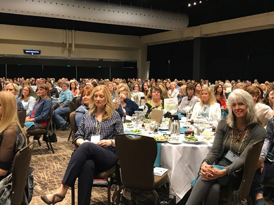 Nearly 850 people attended the Waukesha Women's Center luncheon where gymnast Aly Raisman spoke about sexual assault. People wore denim to the event to draw awareness to misconceptions about victims.