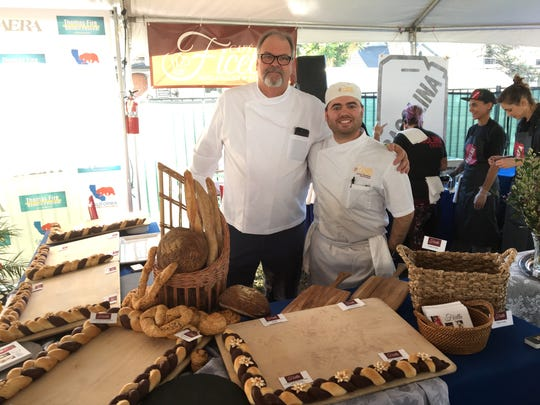 Chef Bryan Scofield, left, and baker and son-in-law, Jarrett Chambers, pose in the Cafe Ficelle booth during the Feb. 3 Thomas Fire Benefit Festival in Ventura.