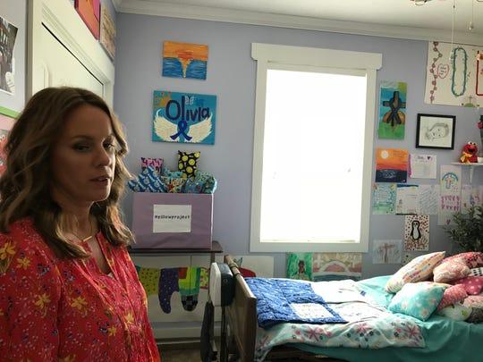 Lisa Borodychuk, in her late daughter Olivia's room