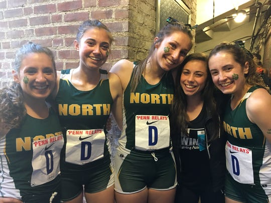 Members of North Hunterdon's distance medley relay pose with injured teammate Elena DiMarcello (in black shirt) after placing third.