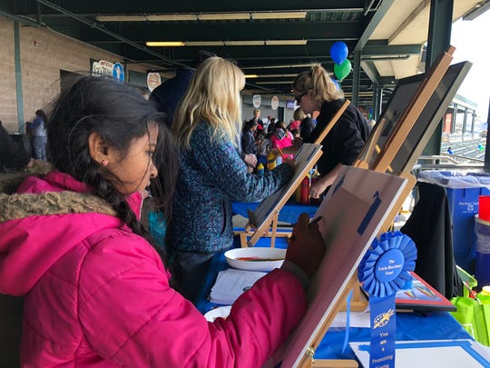 Neelakshi Thanan, age 10, of Warren sketches at an artist's easel, one of the many activities at Healthy Kids Day. She and her family came to the event to explore the activities offered.
