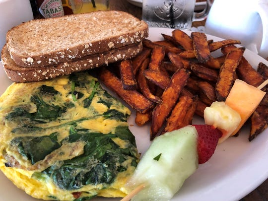 The Greek omelet with wheat toast and sweet potato fries at Doreen's Cup of Joe, Marco Island.