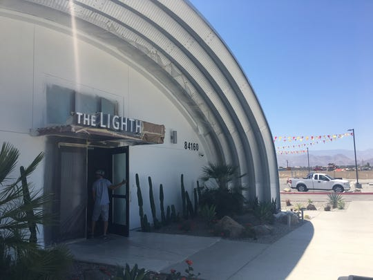 A customer enters Coachella's first licensed dispensary, The Lighthouse, on Avenue 48. Coachella and Palm Springs each received money from the state to help members of minority communities open cannabis businesses.