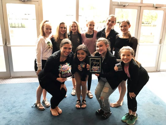 Valerie Kelly poses with the Junior and Senior members of her company at the recent StarQuest competition in Knoxville.