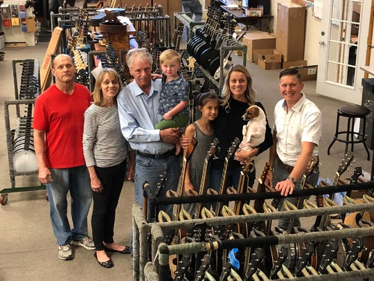 The Rogers family inside the Gold Tone facility on
