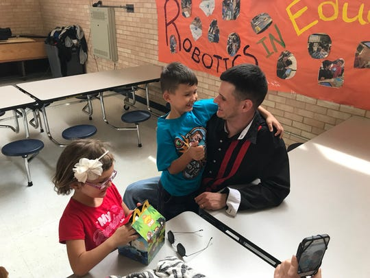 Sgt. Gregory Heidenescher surprised his son, Elijah, center, on his eighth birthday Friday at Schuster Elementary School in Northeast El Paso. Heidenescher had been stationed in South Korea for the past year. Daughter Bridget, 5, is at left.
