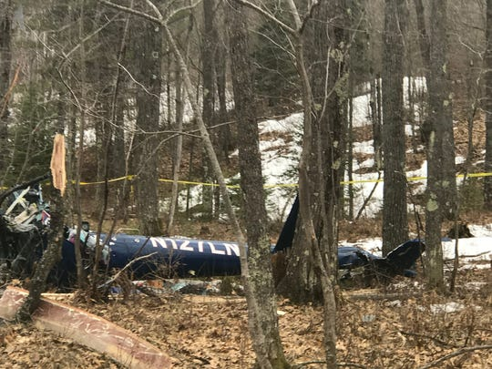 A medical helicopter is crumpled in the woods south of Minocqua on Friday, April 27, 2018 after crashing the night before. The pilot and two medical crew members died in the crash, authorities said.