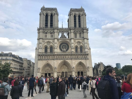 The Michigan football team visits the Notre-Dame Cathedral