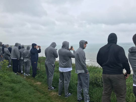 Michigan football players visited Normandy in France