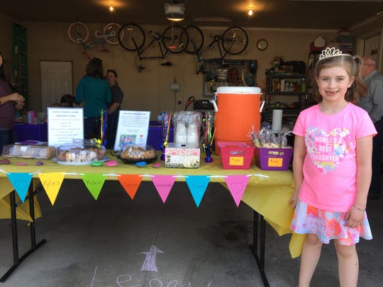 7-year-old Kylie Myers-Schleif at her Kickin' Cancer Lemonade Stand on Sunday, April 29.