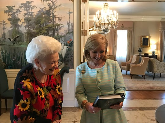 """Shreveporter Virginia Joyner gave Louisiana First Lady Donna Edwards a copy of First Baptist Church Shreveport cookbook """"A Shining Feast"""" during a stop at the Governor's Mansion while on a short Louisiana Tour."""