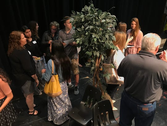 Students and parents gather for a reception following the reveal of Abilene High School's Top 25 of the Class of 2018 Monday.