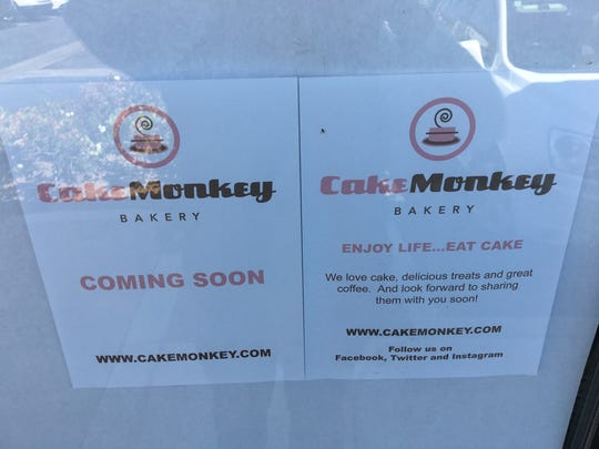"""Coming soon"" signs are seen on the doors at the future Cake Monkey Bakery location in Westlake Village."