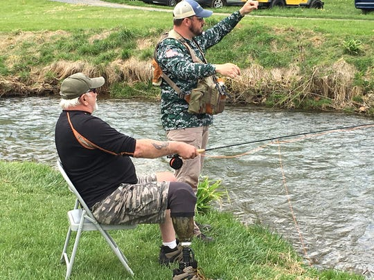 John Jenkins, right, a U.S. Navy veteran, and Doug Massie, a Marine who served in Vietnam, spent Saturday fly fishing at Beaver Creek in Ottobine as part of a Project Healing Waters event.