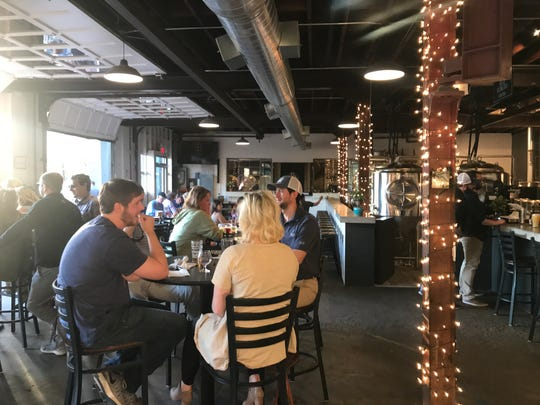 Abridged Beer Company is home to lots of delicious beers in a laid-back, family-friendly atmosphere. Located in a 1950s auto garage, the brewery has plenty of indoor/outdoor seating beneath strings of warm bistro lights.
