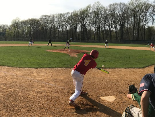 Bergen Catholic batter Cade McDermott connects with