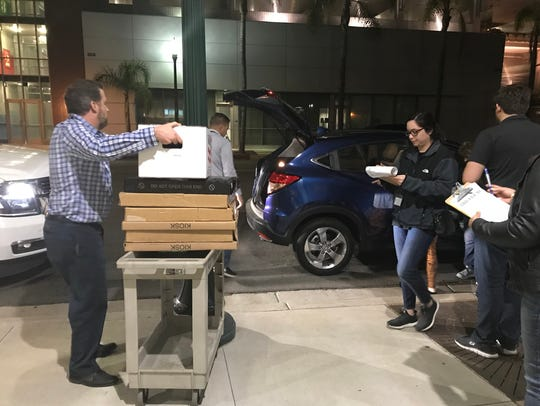 Oxnard election workers unload ballots arriving at