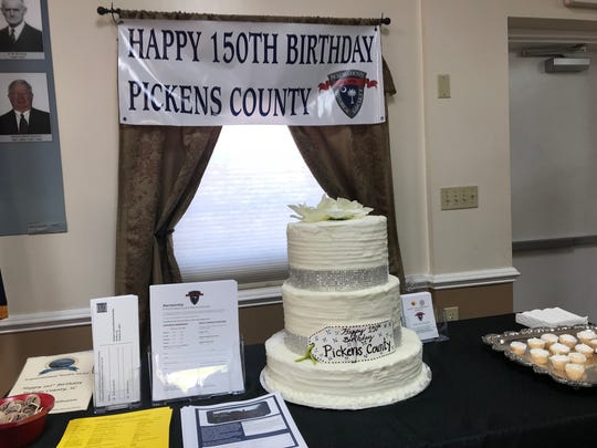 A cake and banner celebrating the Pickens County Sesquicentennial
