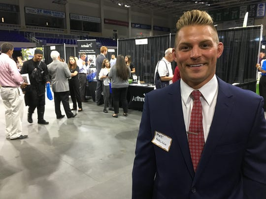 Matt Vercillo, 27, who recently moved to Estero from Iowa to be closer to family, took part in Wednesday's regional career fair at Alico Arena.