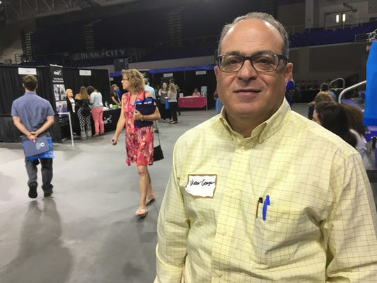 Victor George, of Port Charlotte, attended Wednesday's regional career fair at Alico Arena.