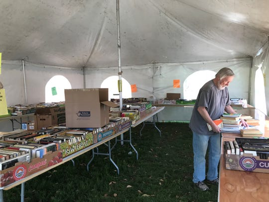 Friends of the Library President George Petersen sorting