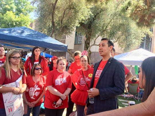 "Arizona Rep. Tony Navarette, D-Phoenix, stopped to talk with teachers from Arrowhead Elementary in the Paradise Valley Unified School District. ""Stay focused on your priorities and your mission,"" he told them. ""Your voices are critical at this time."""
