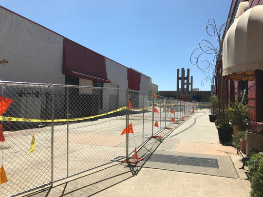 Crews are expected to start demolishing the old Dicker's department store, left, on Thursday. The Redding Chamber of Commerce and Viva Downtown will host a wrecking ball party.