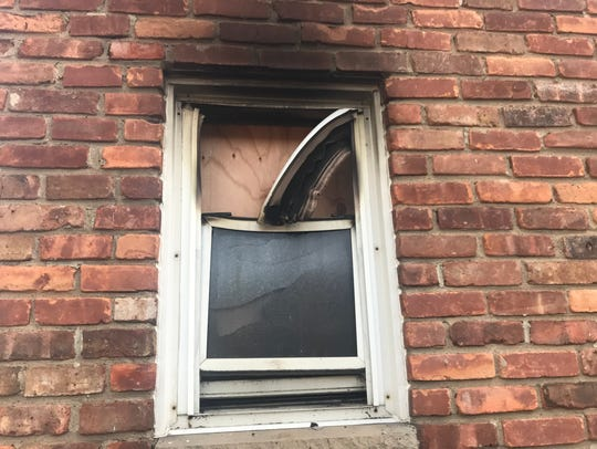 Fire damage is seen outside a Cambridge Village condominium on Littleton Road in Parsippany. May 3, 2018
