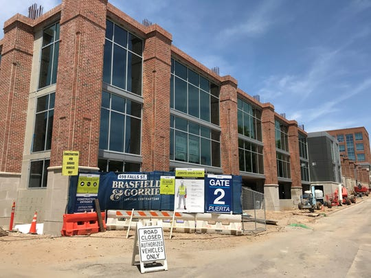 Starting this summer, an apartment building will rise atop this three-story structure on Falls Street in downtown Greenville, developers say.
