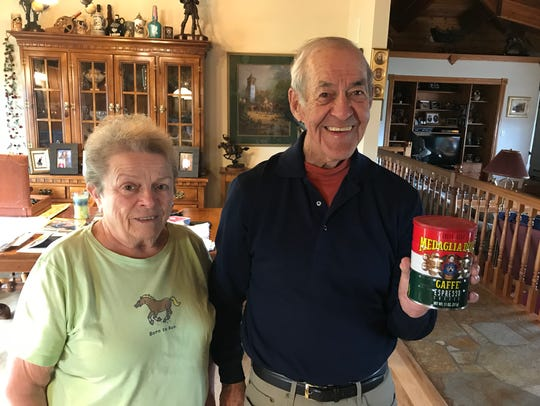Joyce and Al Bell display a can of Medaglia d'Oro coffee