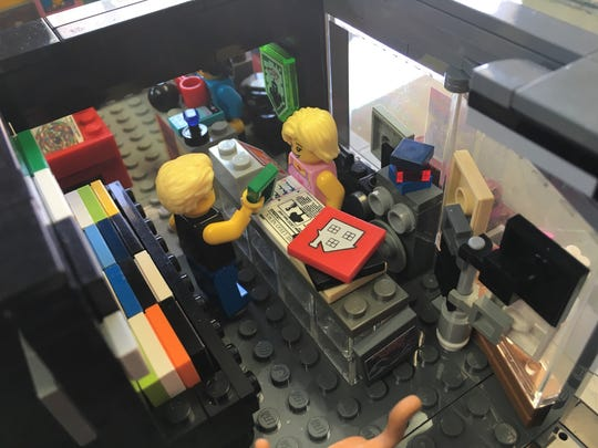 Lego version: Total Drag interior, a patron hands money to co-owner Liz Nissen.