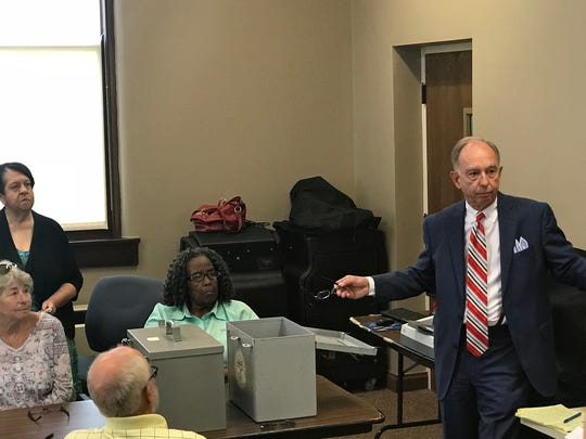 Knox County administrator of elections, Cliff Rodgers, explains the provisional ballot process before the votes were tallied Thursday.