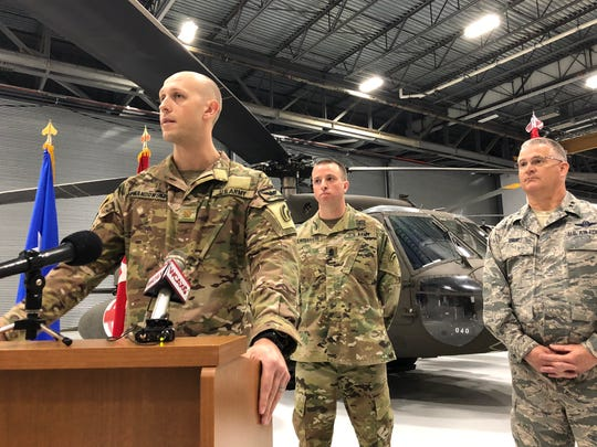 Maj. Jamie Lewandowski, at the podium, commander of a Vermont Army National Guard air ambulance unit, speaks at the announcement of his unit's deployment to Southwest Asia starting in June. The announcement was made at the Guard base in South Burlington on Friday, May 4, 2018.