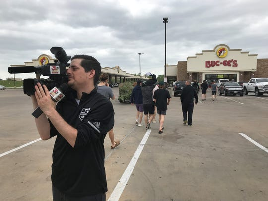KTBS' Alex Anderson films the action as the Shreveport