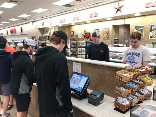 The Shreveport Mudbugs order sandwiches at Buc-ee's