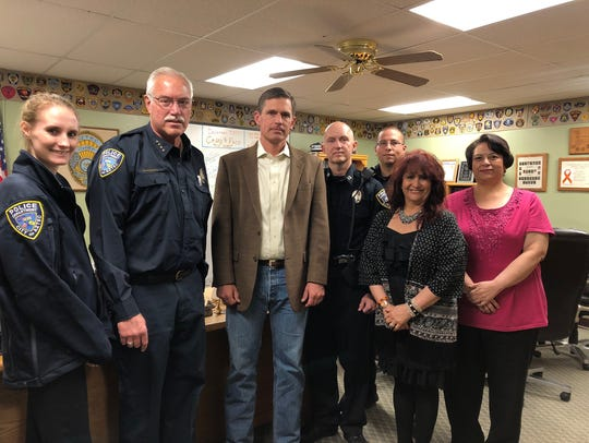 Members of the Aztec Police Department pose for a photo with U.S. Sen. Martin Heinrich during his visit to the Four Corners on Tuesday in Aztec.