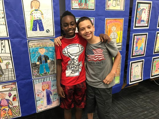 Ten-year-olds Jacob Payne, left, and Logan Tew sent a letters to the Brown Foundation after Linda Brown died. Without her, Jacob said, they wouldn't have been friends.