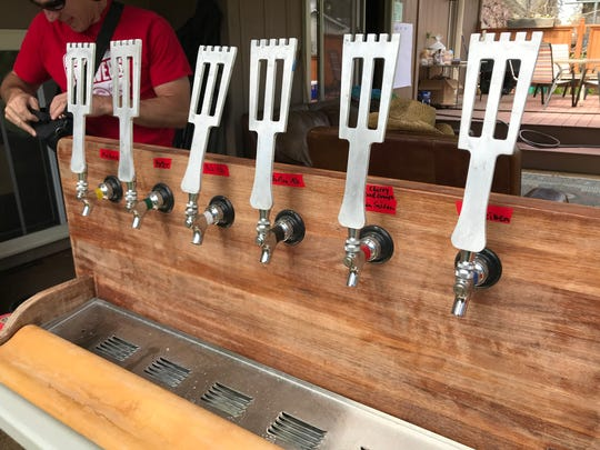 Taps featuring beers made by Liquid Poets Society homebrew club members.